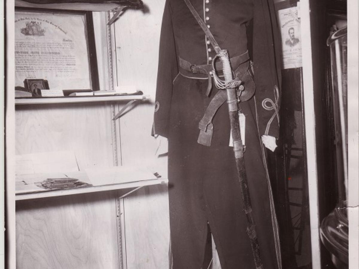 This is an image of the display case that held Captain Thomas Hickey's uniform and sword.